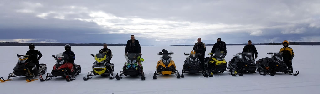 Some of Our Guests Enjoying a Day of Snowmobiling On Larder Lake